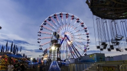 Fair attractions (a ferris wheel and swing ride)