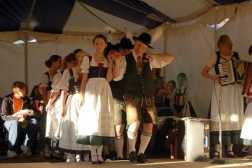 A group of dancers wearing traditional German outfits.