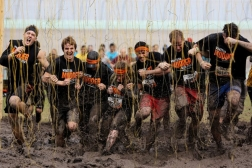 A group of people having fun on the tough mudder course